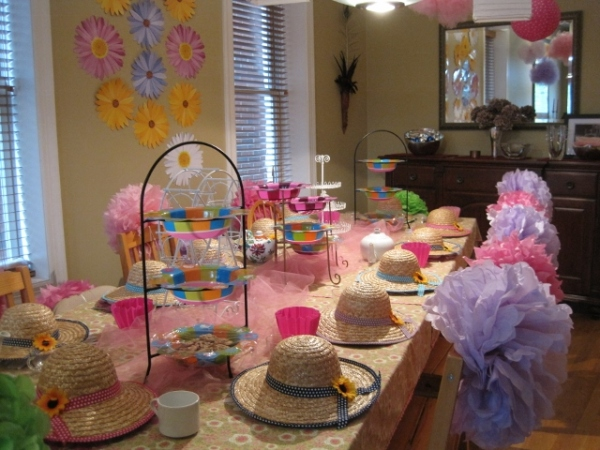A dear friend and consumate party planner loaned me all the decorations for our tea party. Can you say eco-friendly? That should buy me extra points with the selection committee! Right?